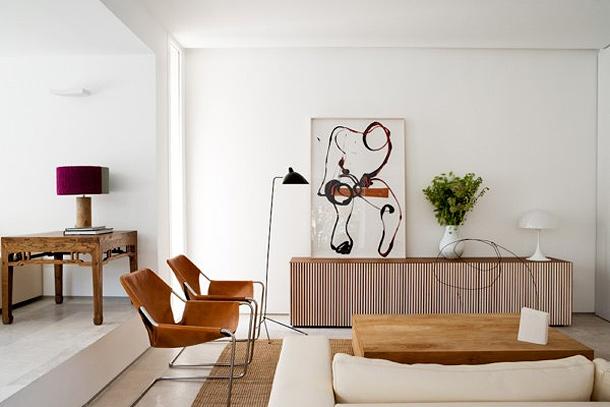 Interiores depurados en un dise o conjunto de baton for Departamentos decorados estilo vintage