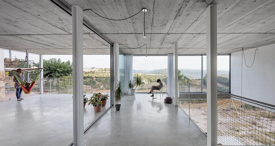 casa unifamiliar del estudio narch con cerramientos technal (5)