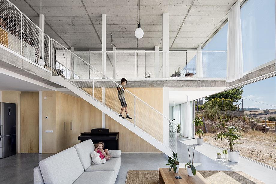 casa unifamiliar del estudio narch con cerramientos technal (2)